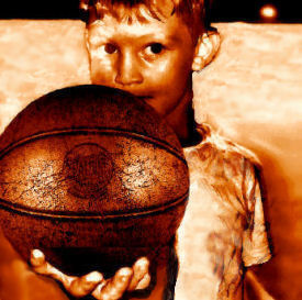 Kid with a vintage leather basketball