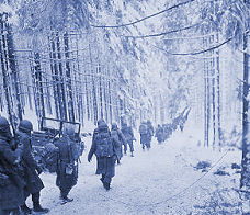 Marching in the snow in the Battle of the Bulge
