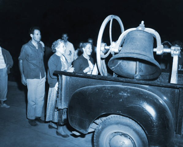 BYU graduating seniors ring Y Bell in 1950s